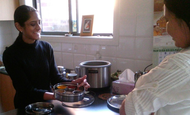 Ayurvedic Doctor Khushdil Chokshi shows a workshop attendee some Indian spices