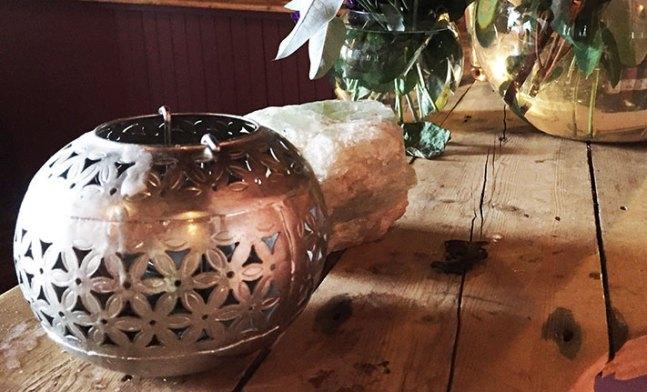 decorative-tea-light on wooden counter