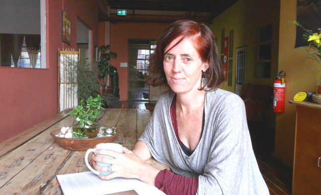 Global Yogi Blogger Michelle Taffe at table in Ashtanga Yoga Centre of Melbourne